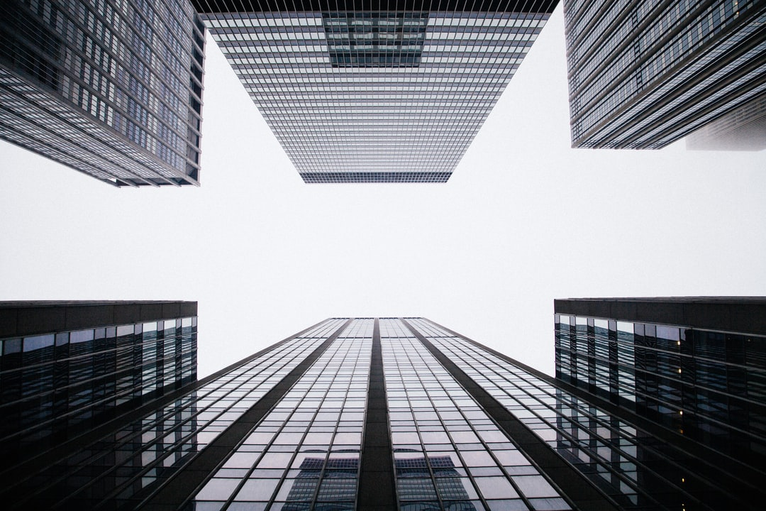 Office buildings under clouds photo by anthony delanoix anthonydelanoix on unsplash