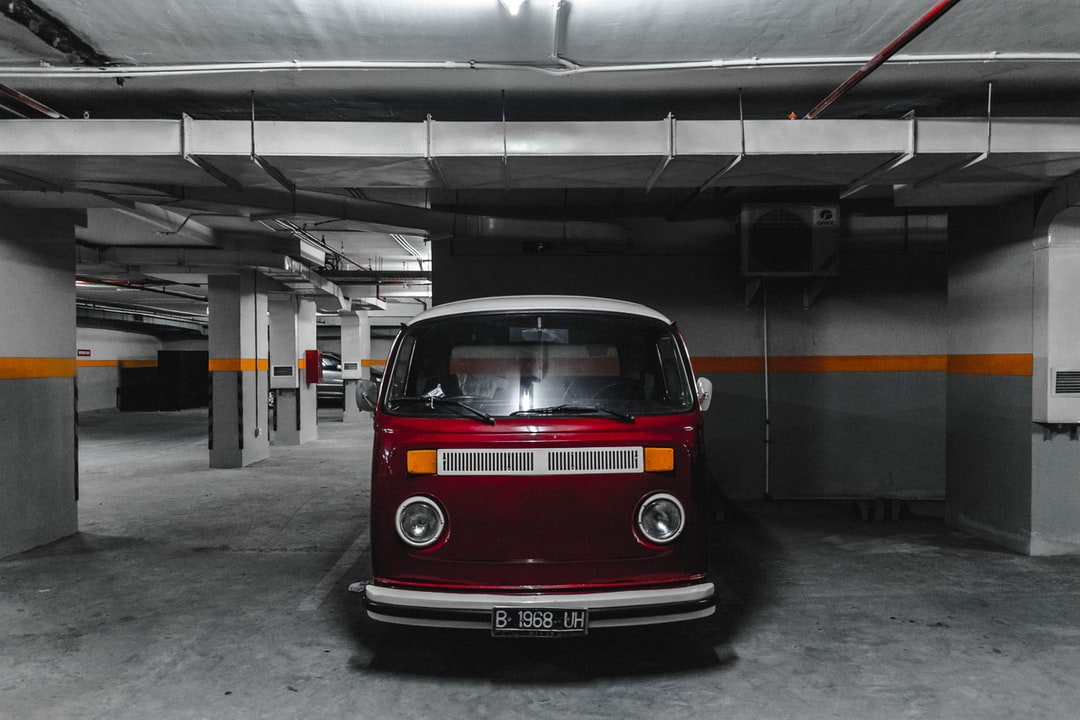 Red minibus parked underground photo by raynaldy dachlan for Garage mj auto