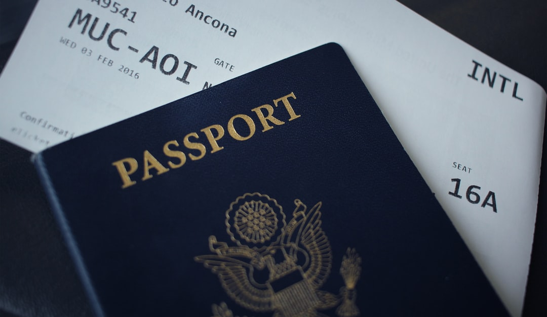 passport booklet on top of white paper photo – Free Image on Unsplash