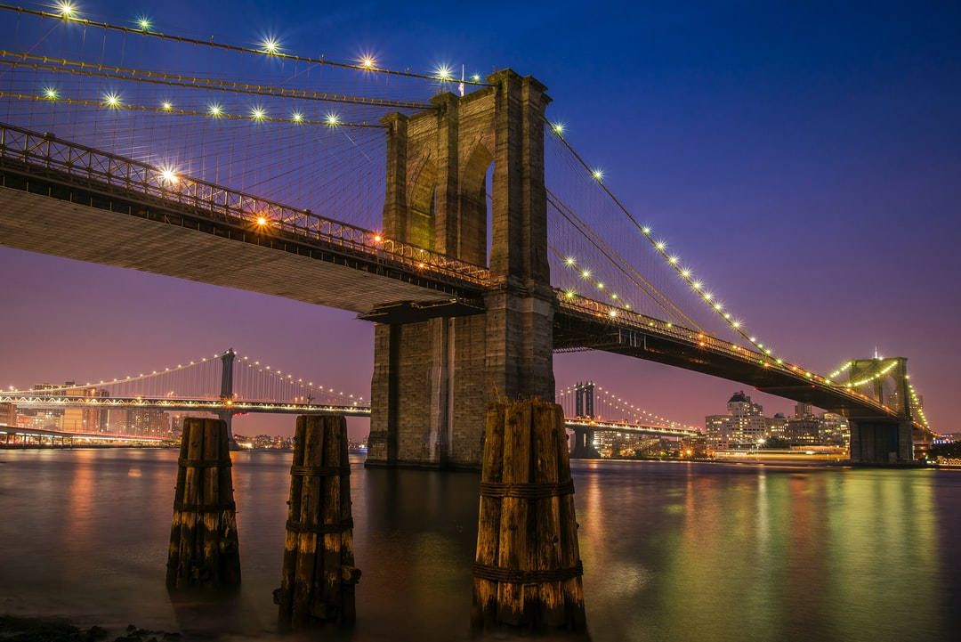 an overview of the suspension bridge between the east river from brooklyn to manhattan island Brooklyn bridge and new york city photos the brooklyn bridge looms majestically over new york city's east river  brooklyn bridge - facts & summary.