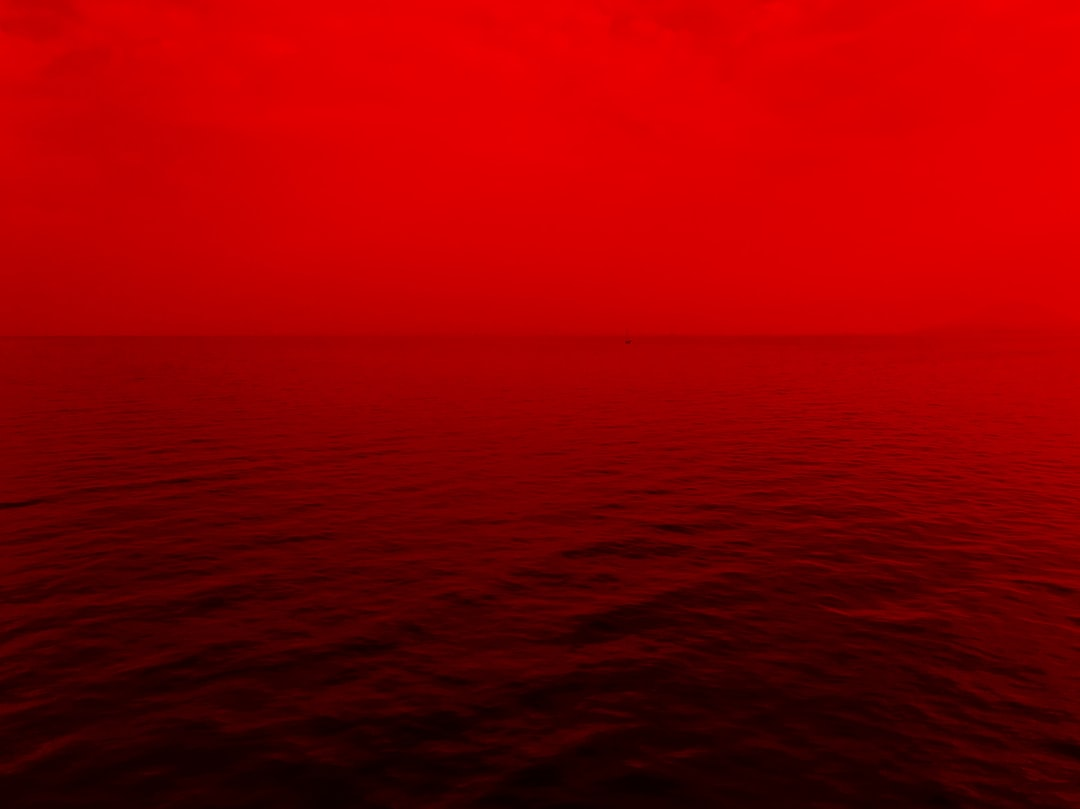 photo of ocean with red lights photo – Free Nature Image ...