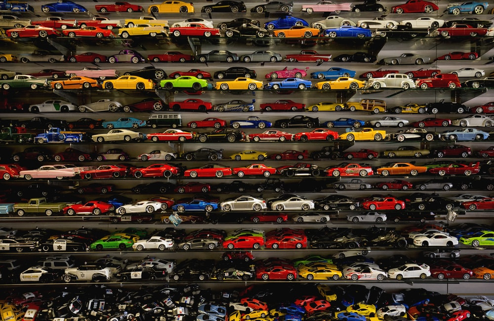die-cast car collection on rack