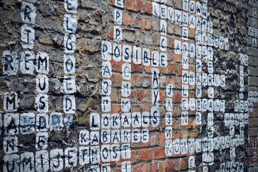 Polyglot crossword on a street wall