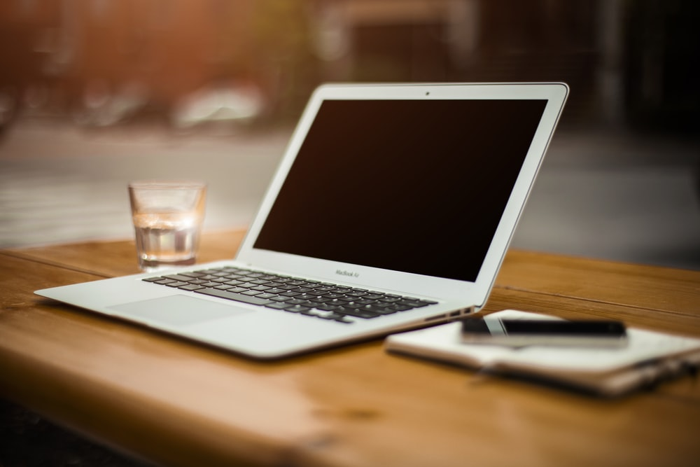 photo of turn-off MacBook Air on table