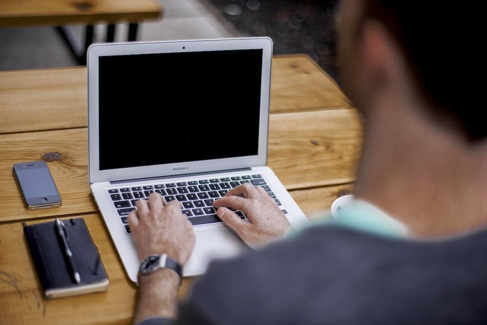 man using MacBook Air