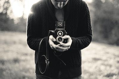 man holds vintage camera