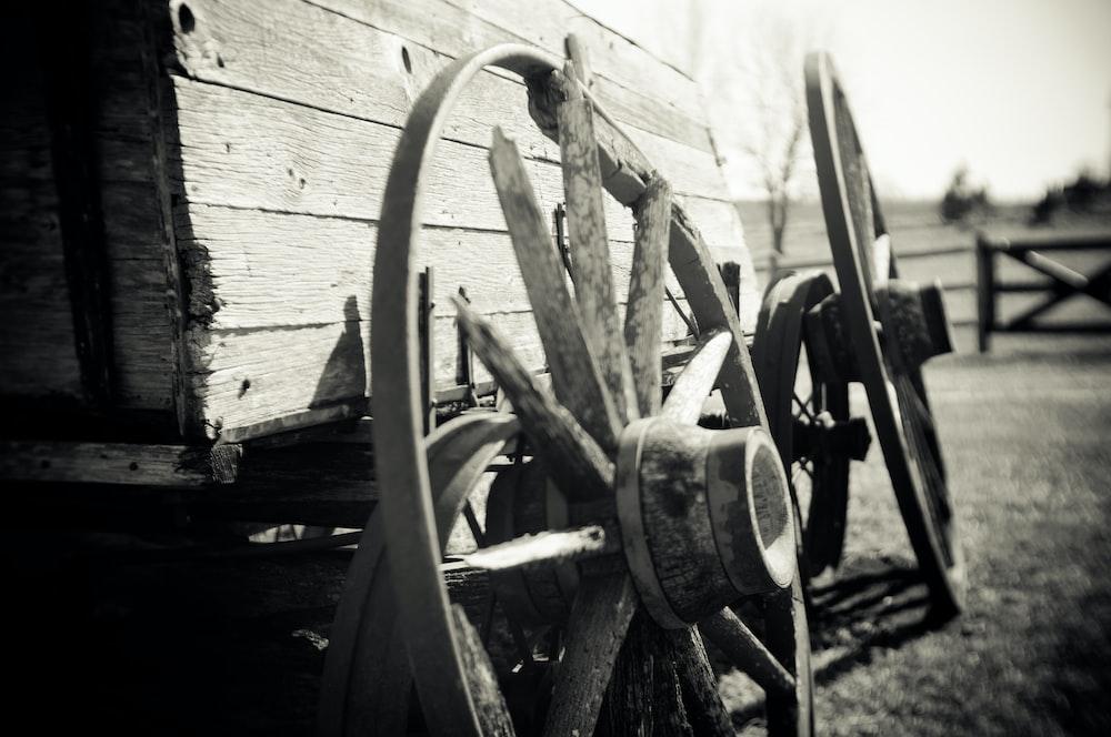 grayscale photo of wagon wheel