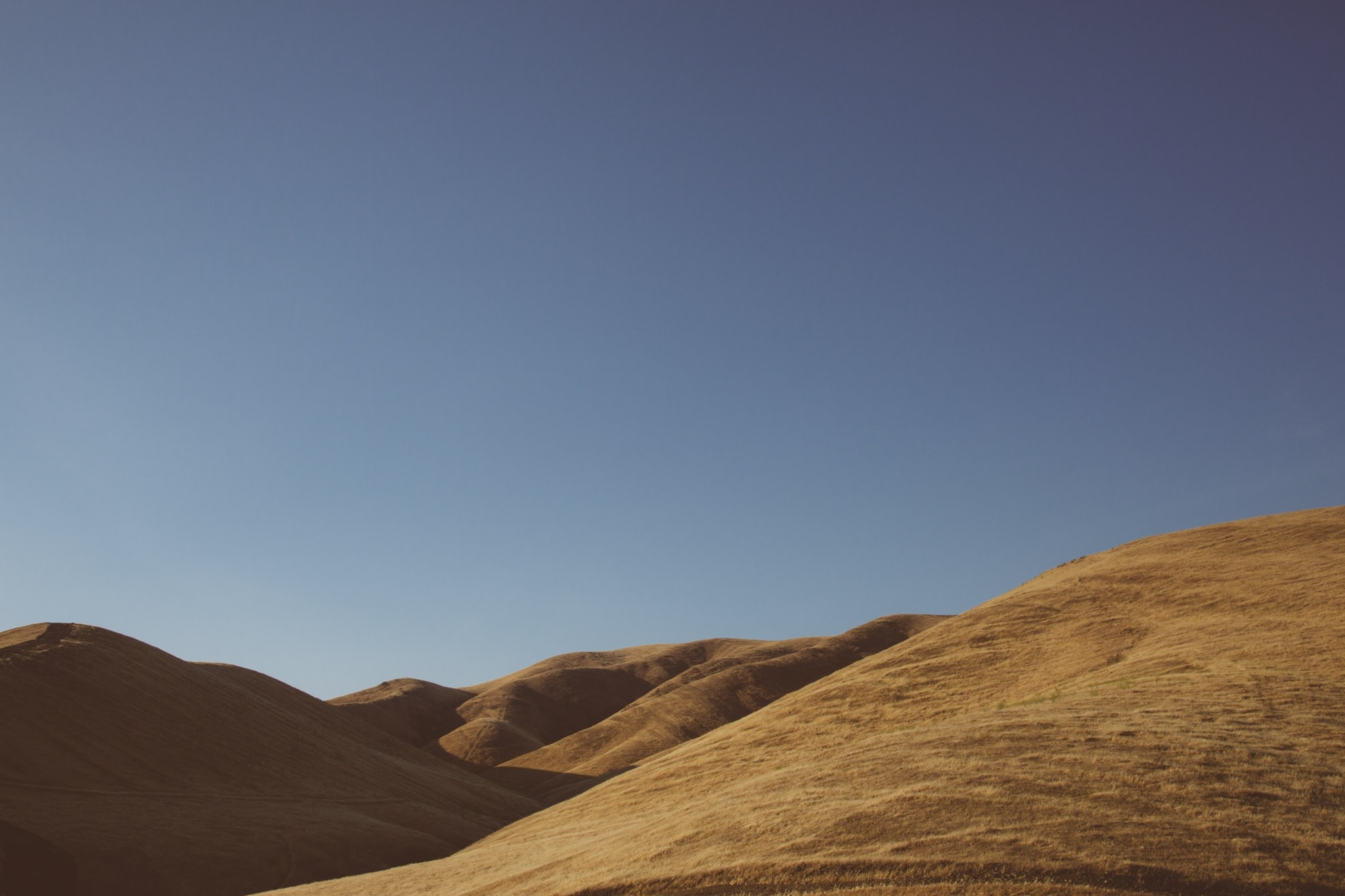 A wide angle shot of arid hills.