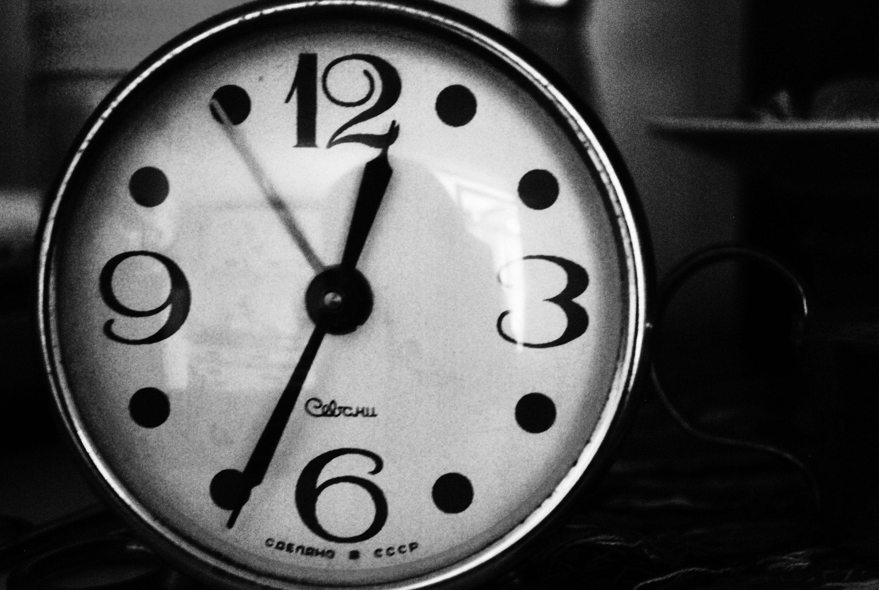 grayscale photo of analog clock
