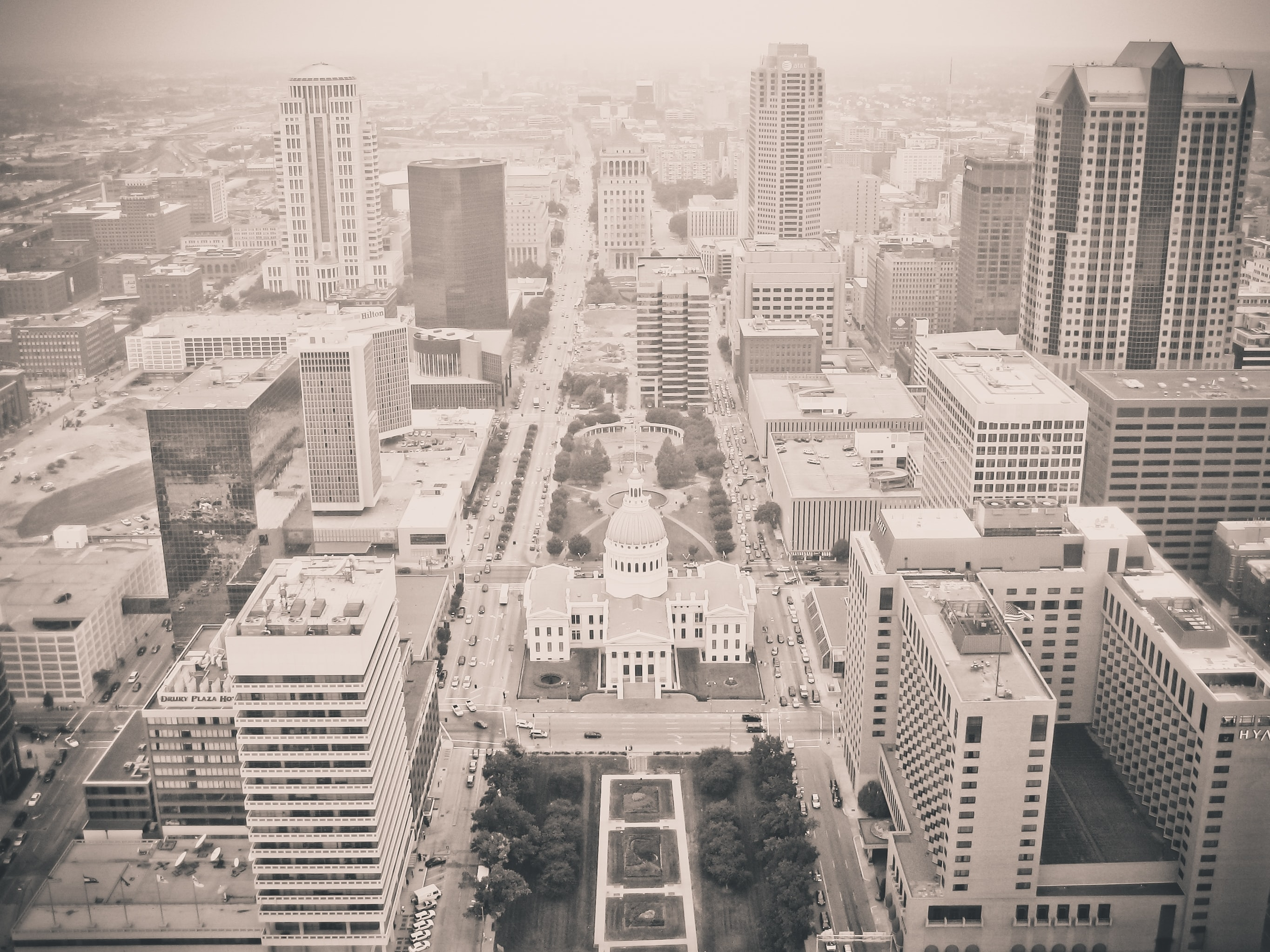 Black and white shot of business district of city from above