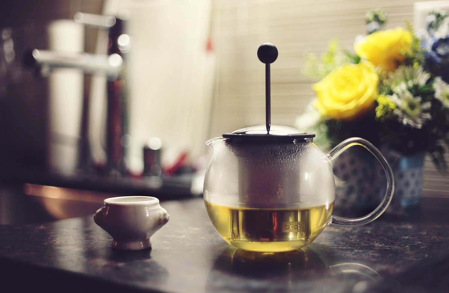 teapot filled with yellow liquid on table