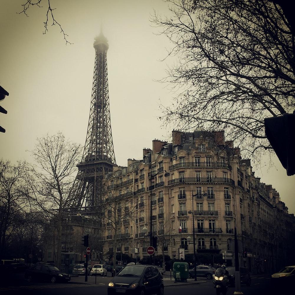 Eiffel Tower behind concrete building