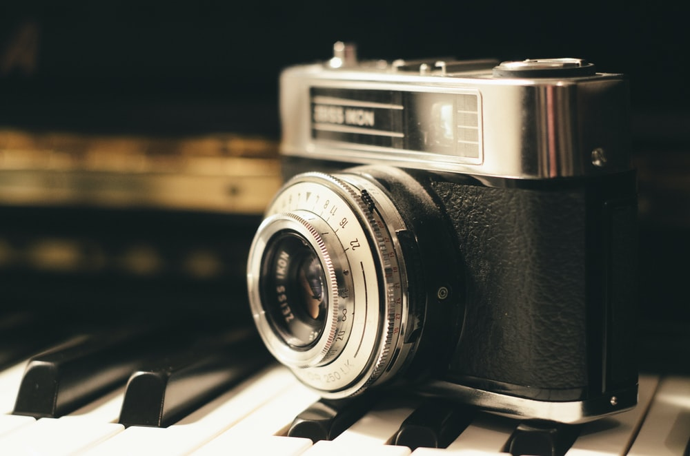 black and silver point-and-shoot camera