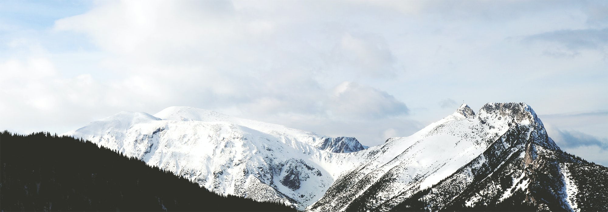 snow capped mountain under white clouds during daytime