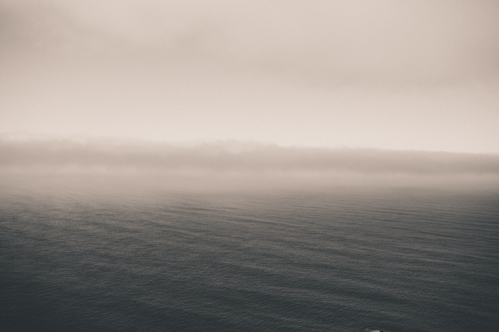 body of water with fog