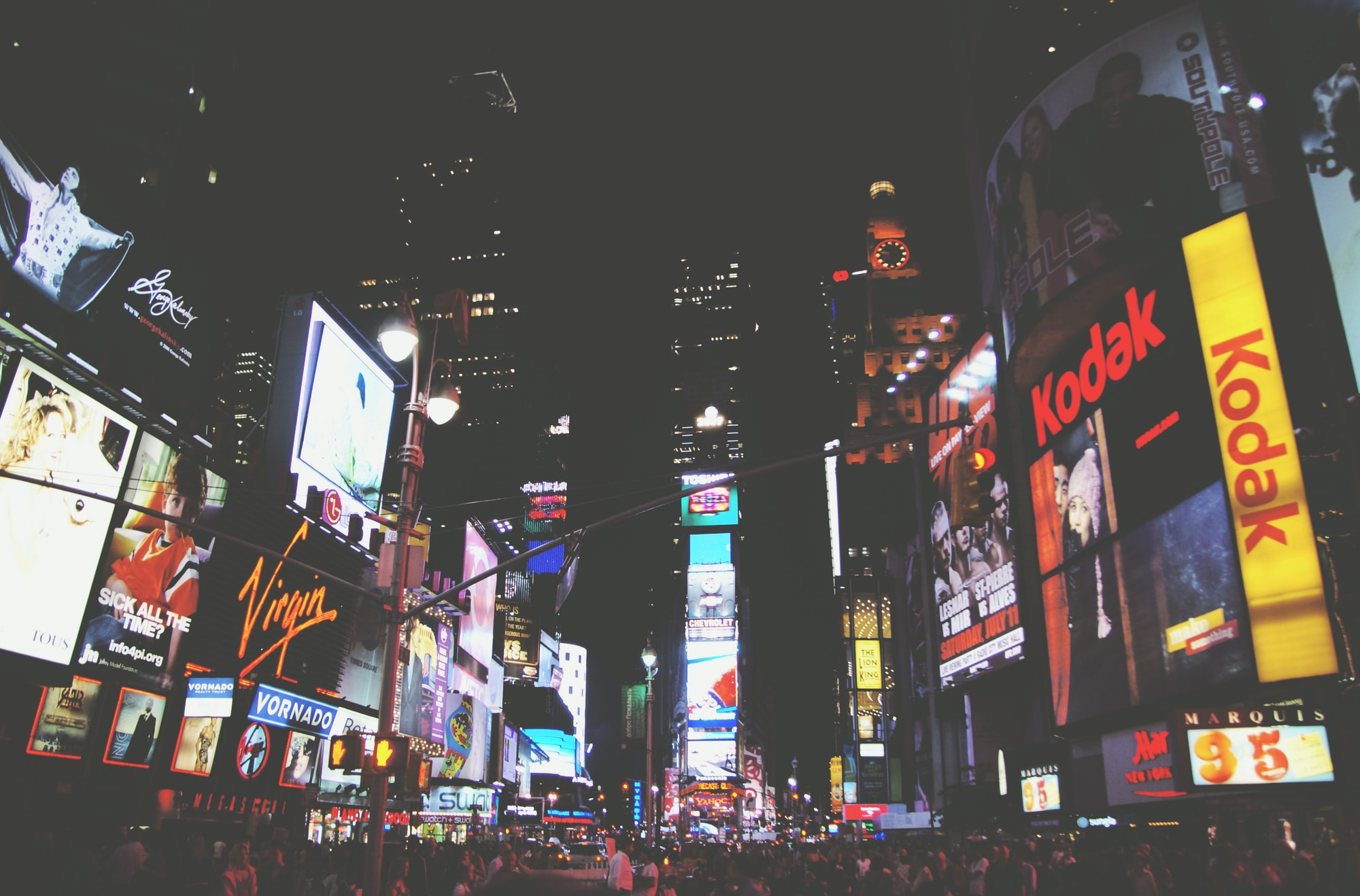 On my way to a Broadway show. Times Square filled with people at night.