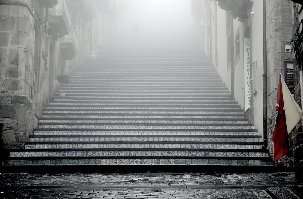greyscale photography of concrete stairways