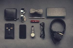 black corded headphones near eyeglasses