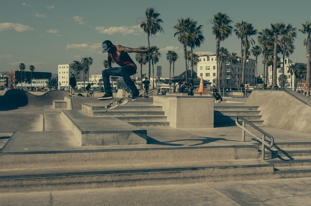time lapse photography of man skateboarding outside