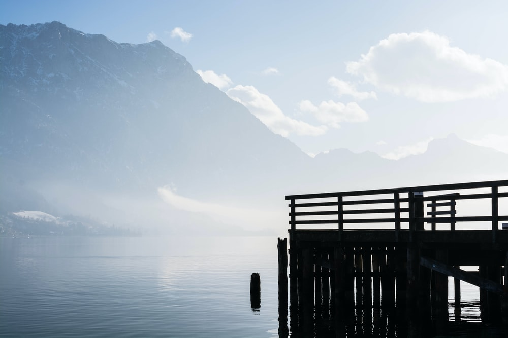 wooden dock with a view of mountain