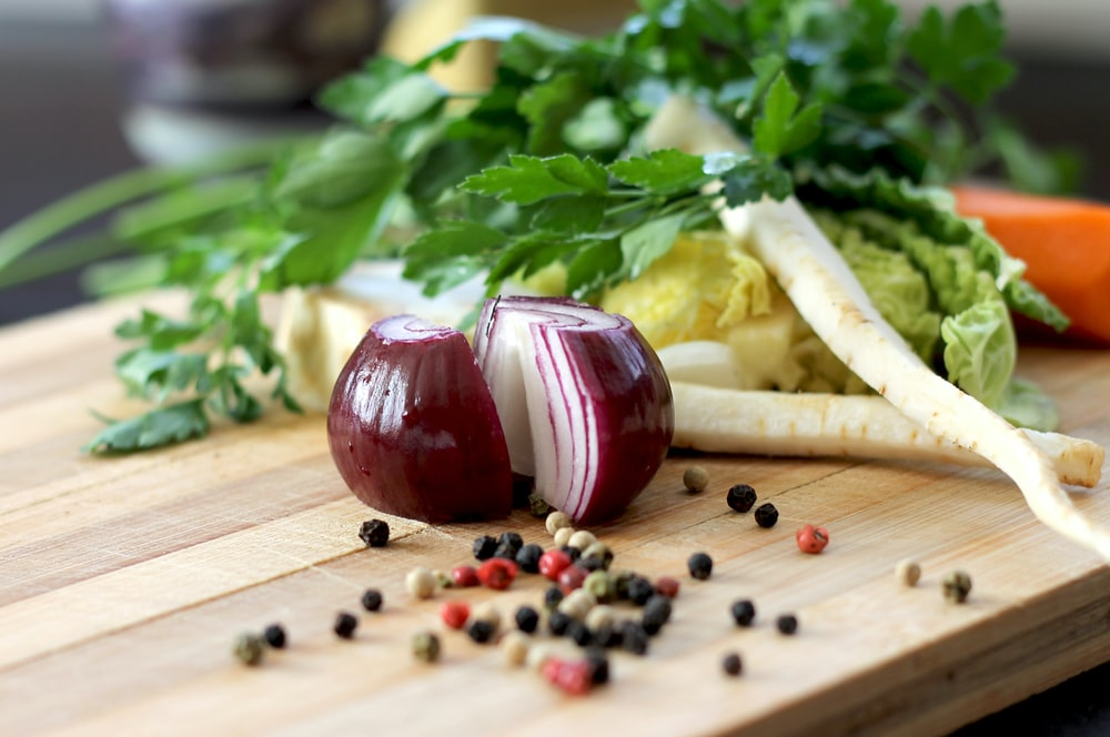 red onion on brown wooden chopping board