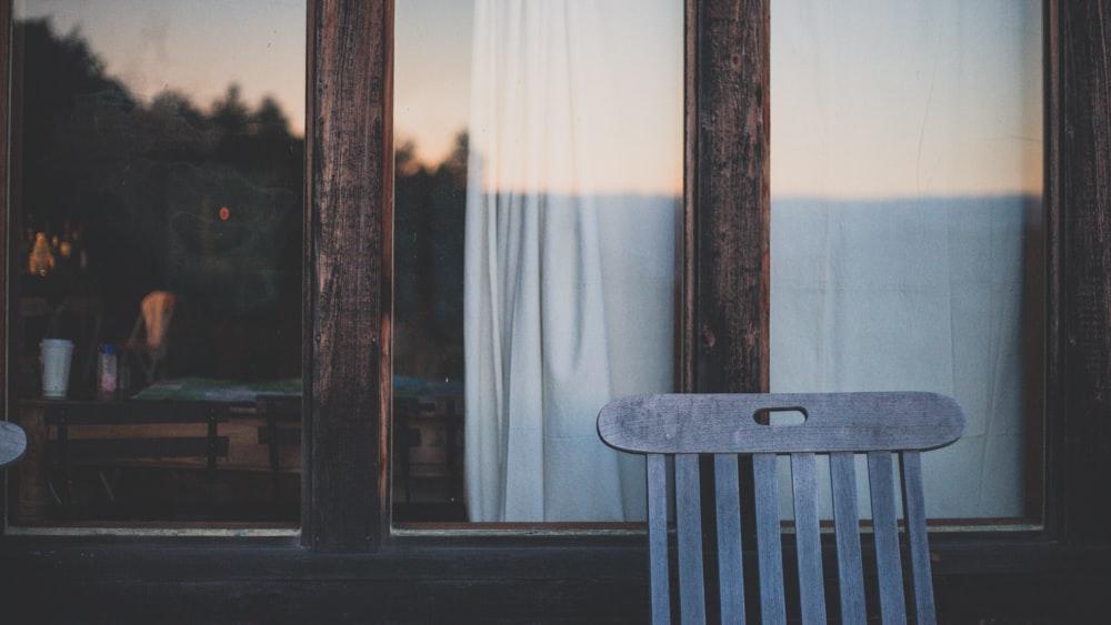 brown wooden chair near brown wooden door