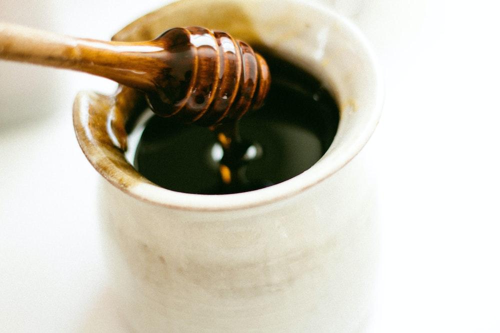 brown wooden honey dipper