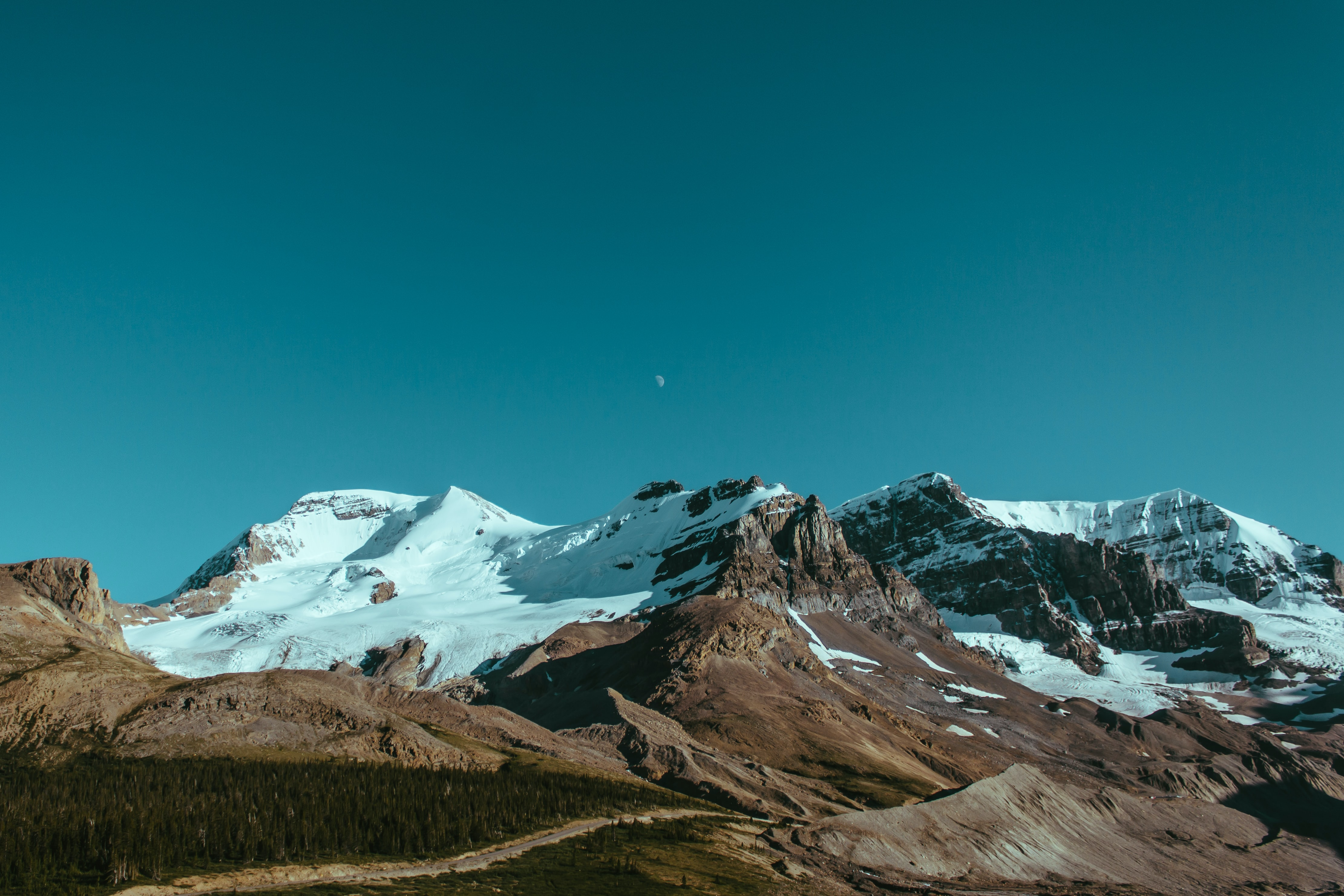 A majestic Alpine landscape of rocky mountains covered in snow