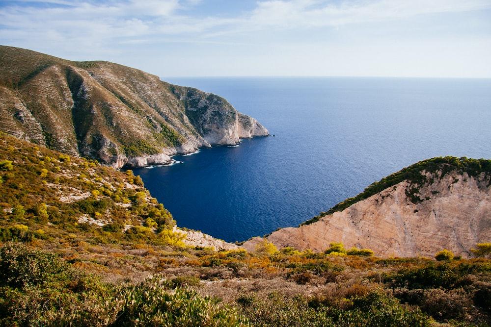 landscape of mountain near ocean