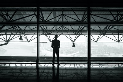 Man looks out airport window