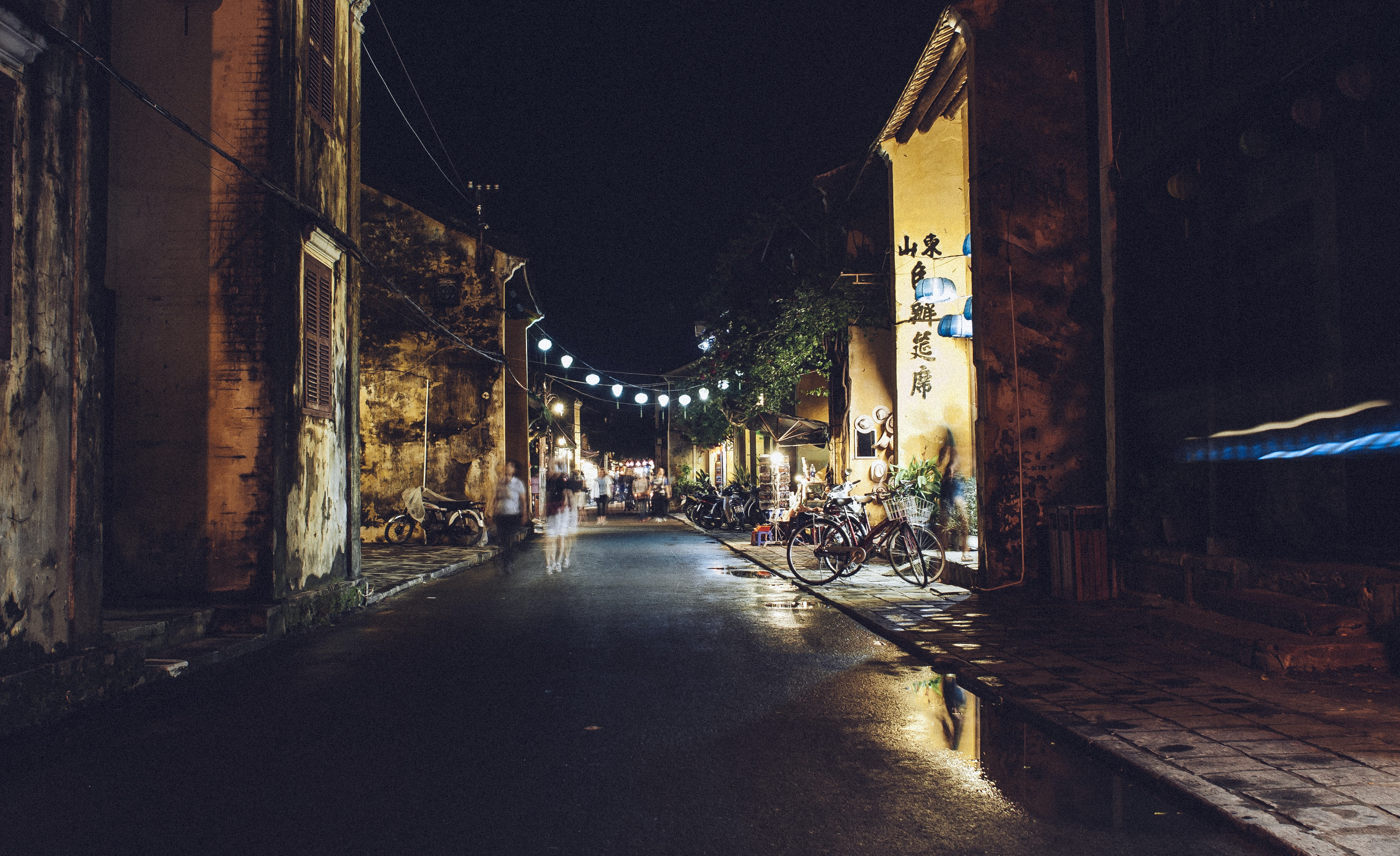 street beside village with lights during night time