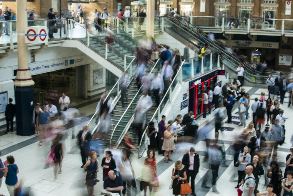 people standing and walking on stairs in mall