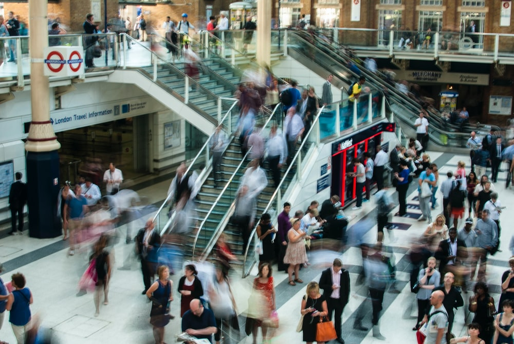 A long-exposure shot of a busy London Underground station