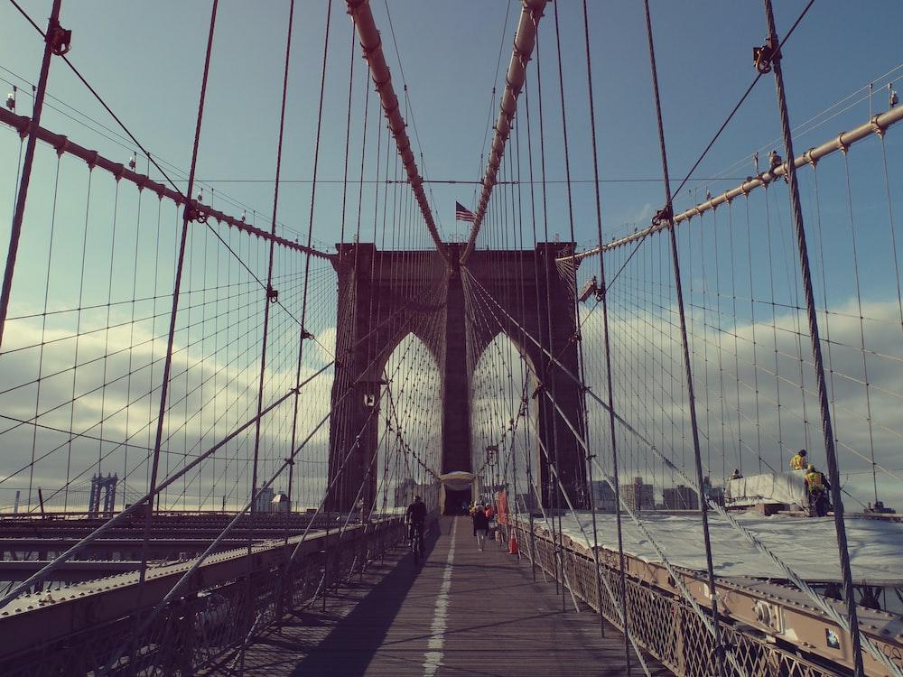 gray concrete bridge under white and blue sky