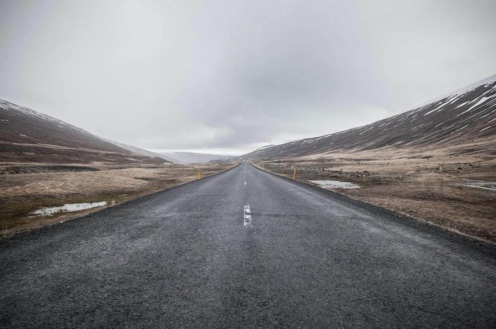 empty asphalt road through mountain