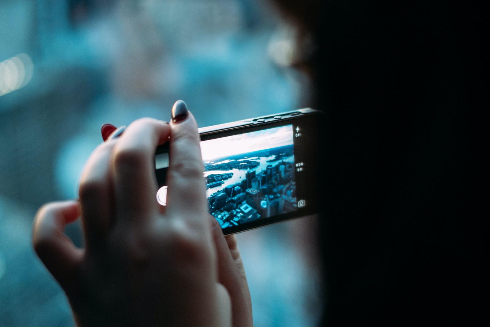 "Fujifilm X-Pro1 sample photo. ""Person holding black smartphone"" photography"