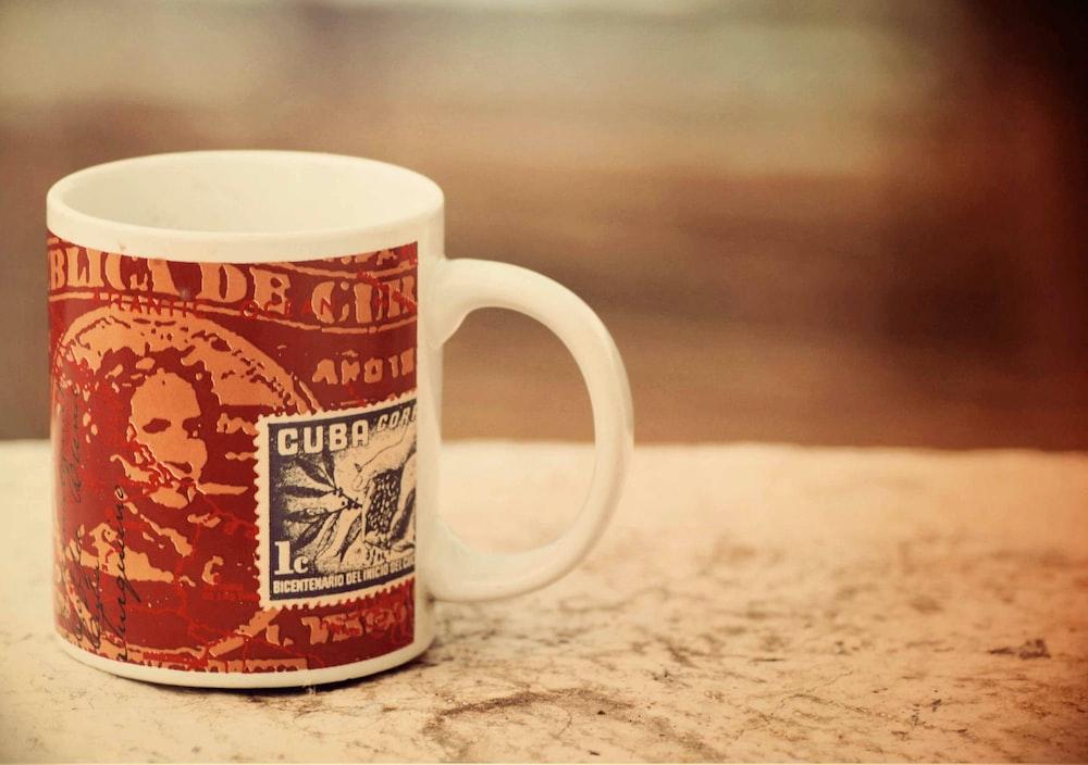 red and white ceramic mug