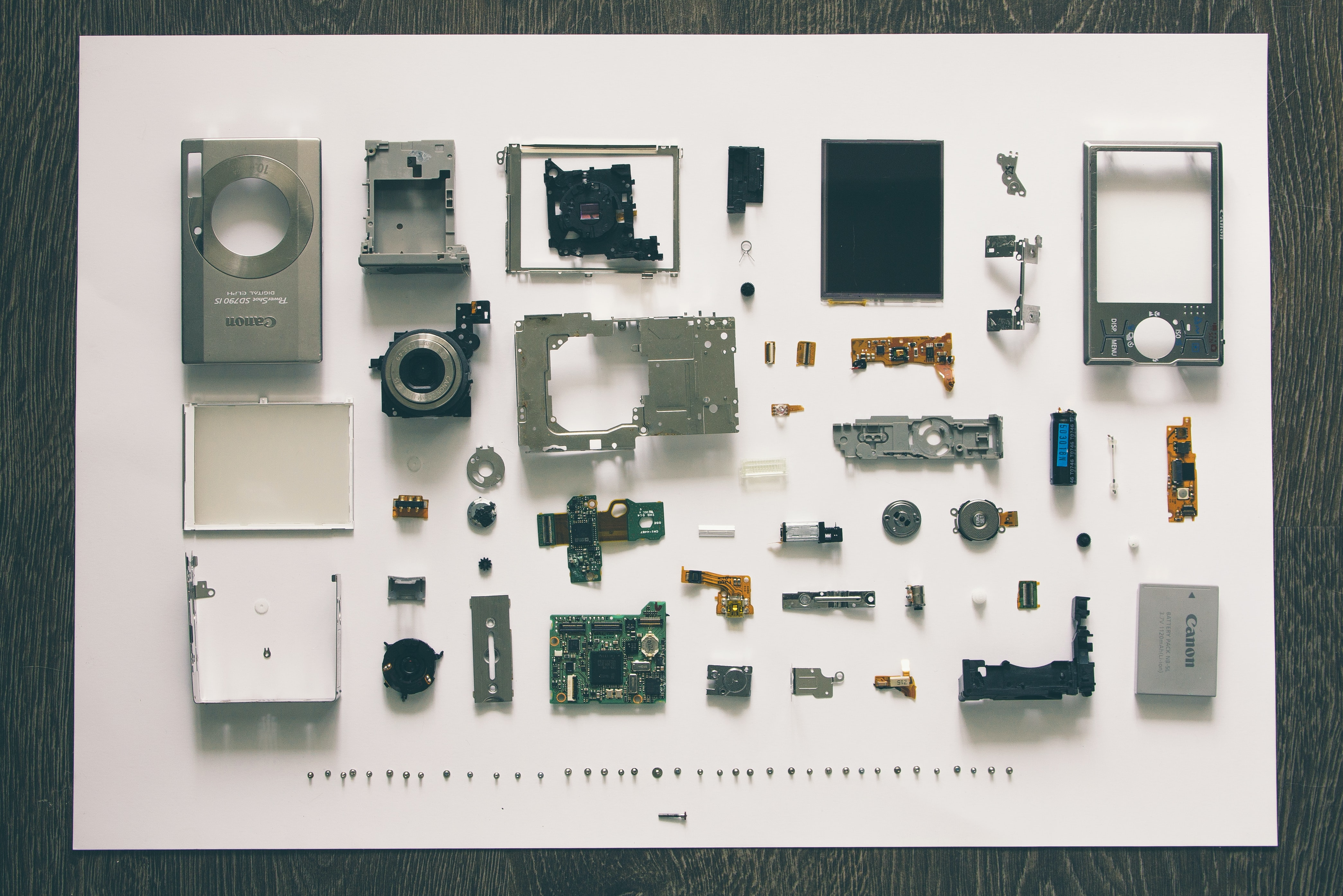 Parts of canon camera components disassembled or waiting to be arranged in good shape.