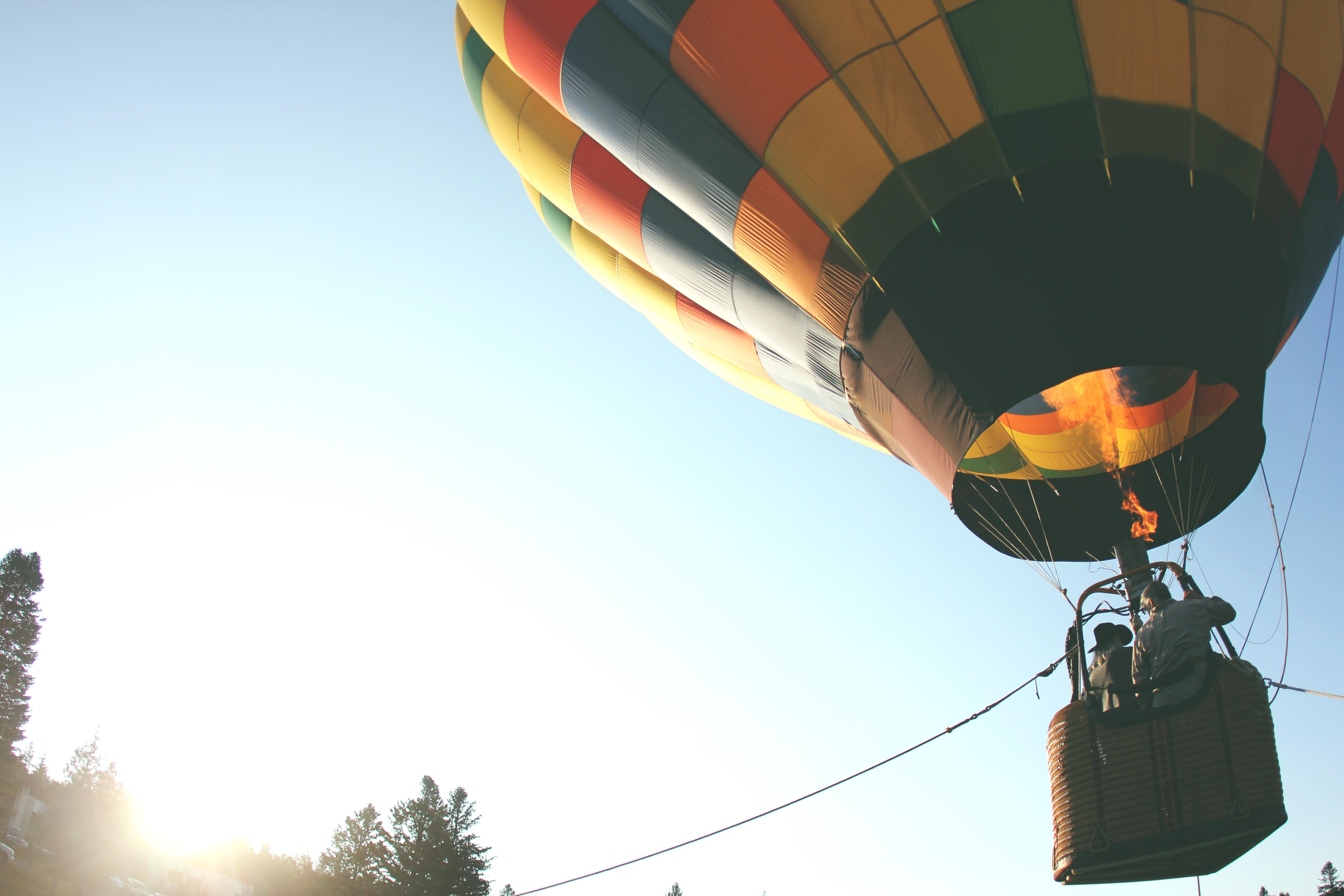 person riding on hot air balloon