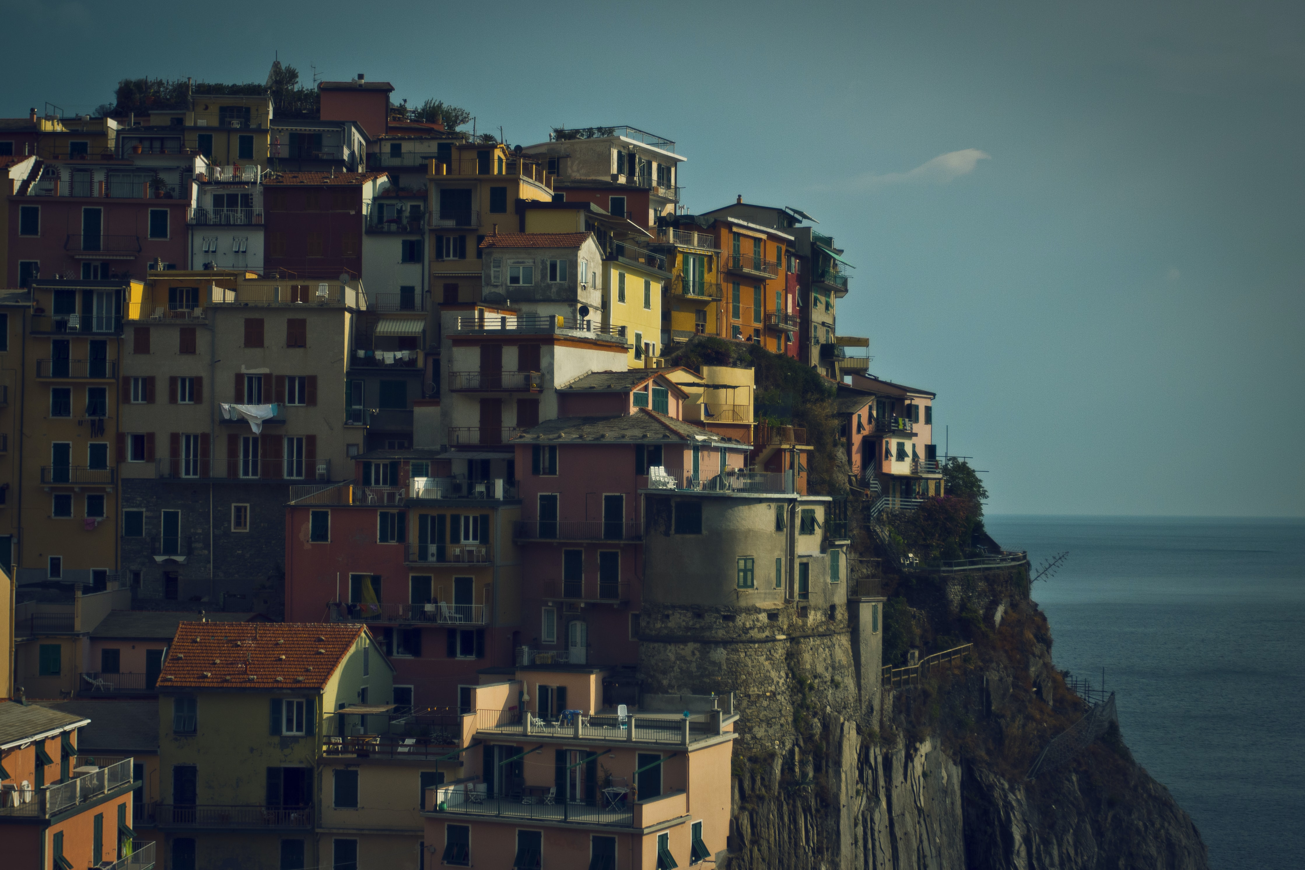 View of a cliff-side village and the sea.