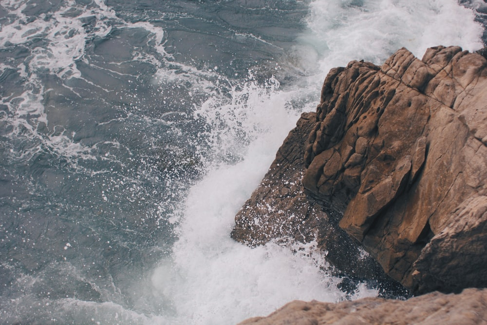 splashing waves on rock