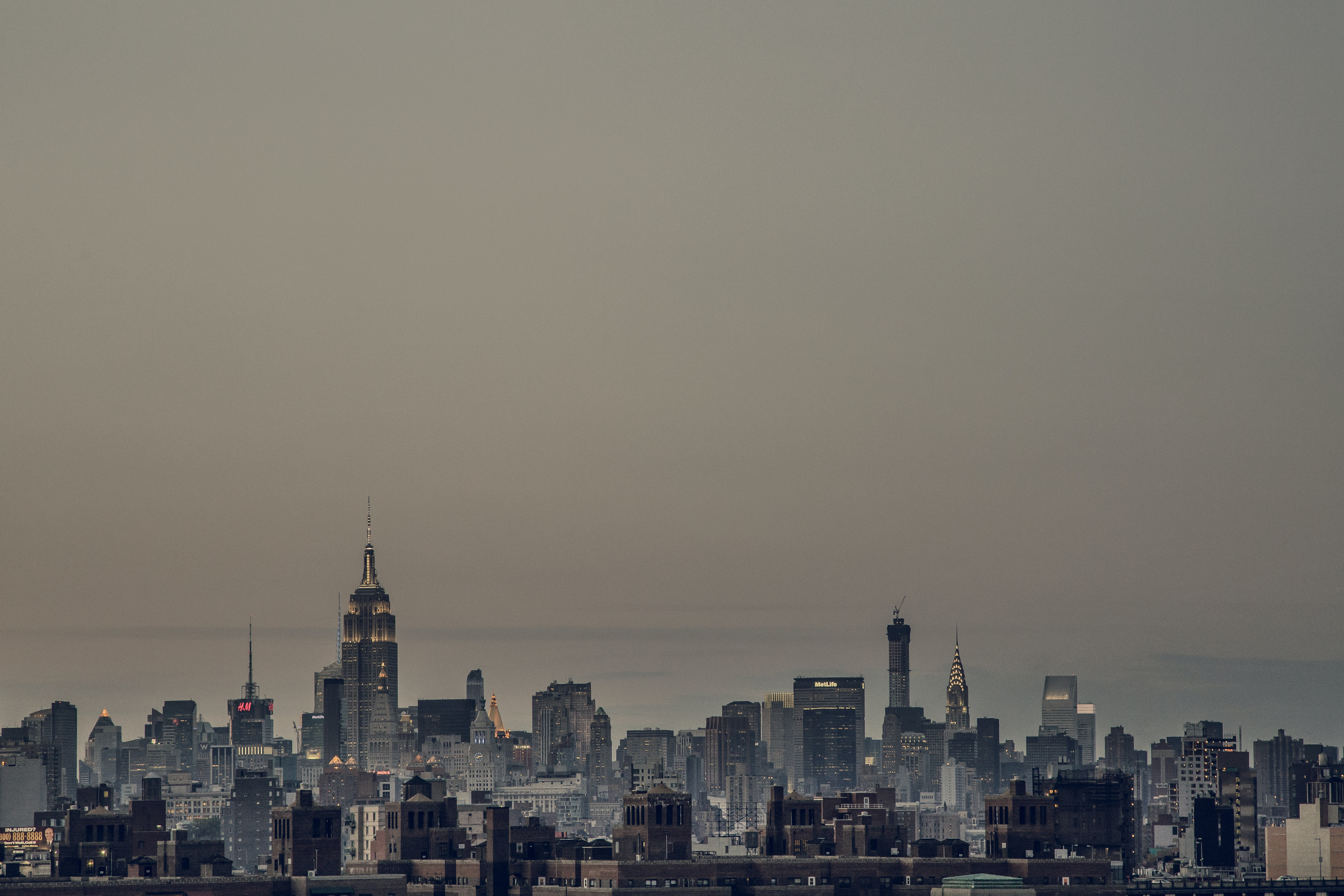 The New York City skyline at night with the sky filled with smog