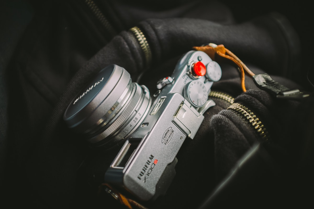 Fujifilm camera on a black zippered photographer's bag