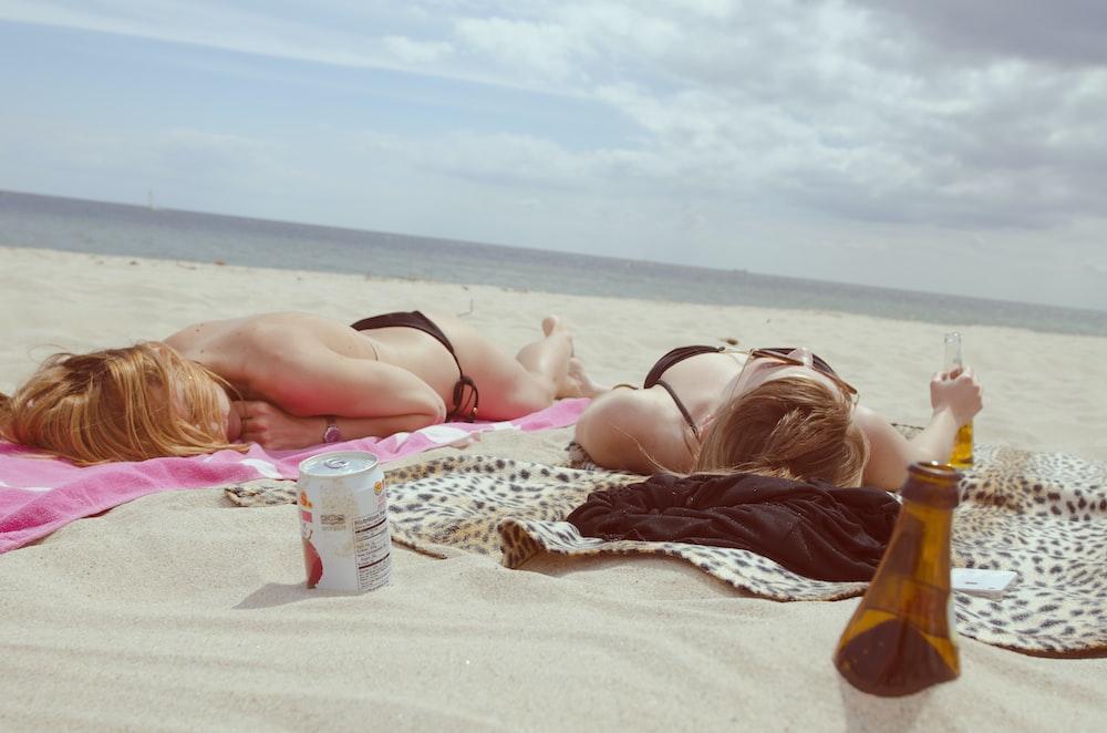 brown glass bottle across two women