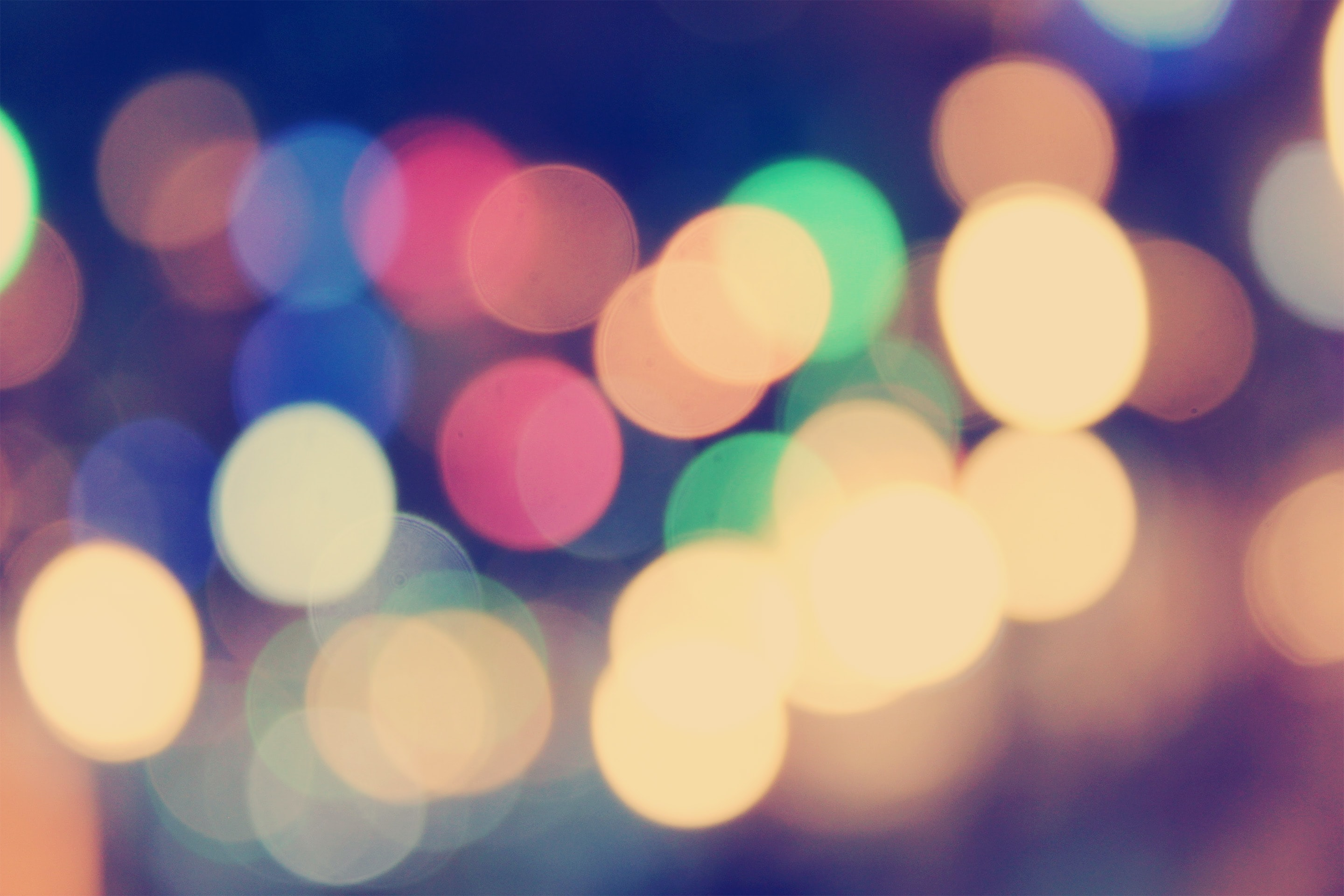 A colorful bokeh effect against a black background