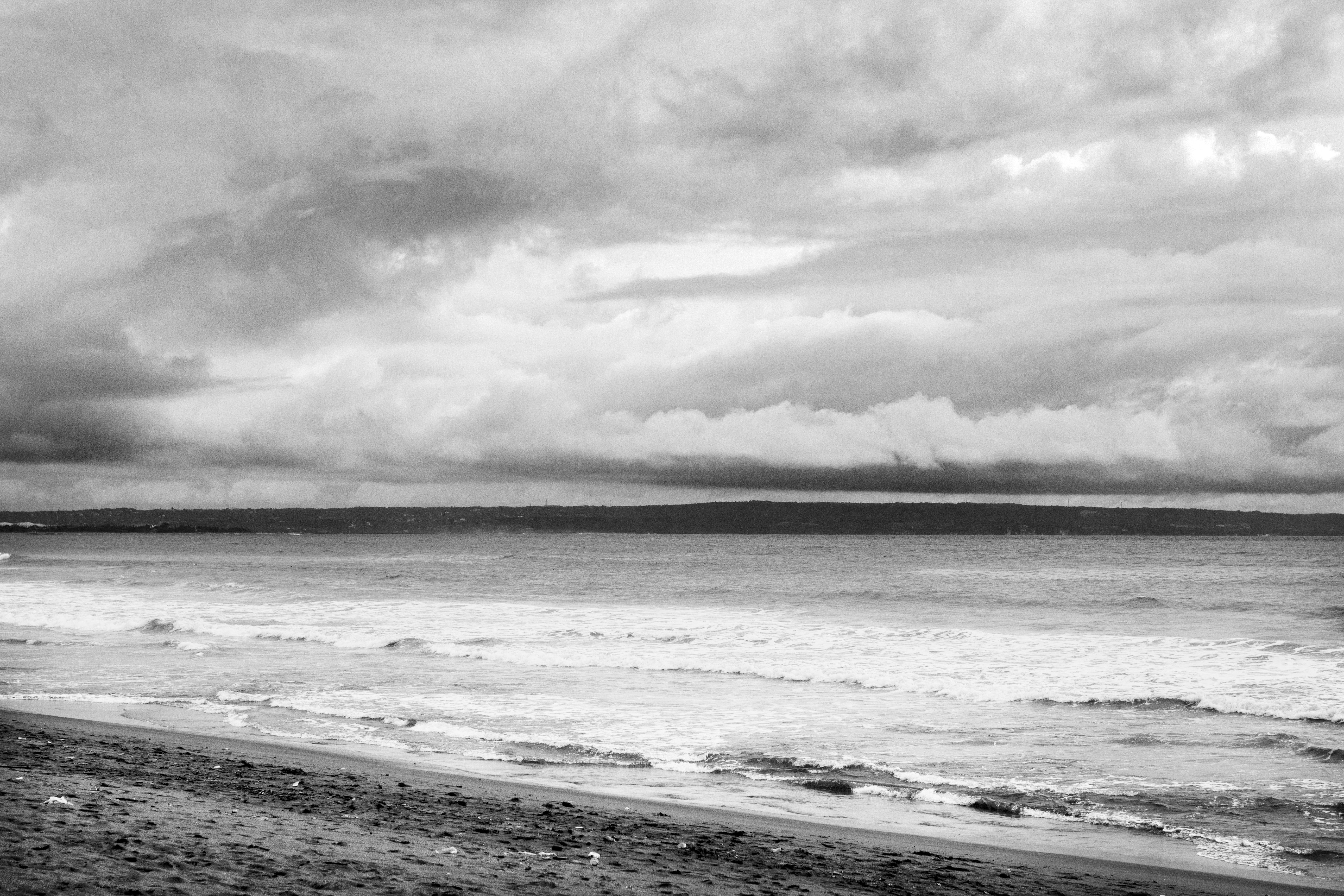 grayscale photo of beach and sea
