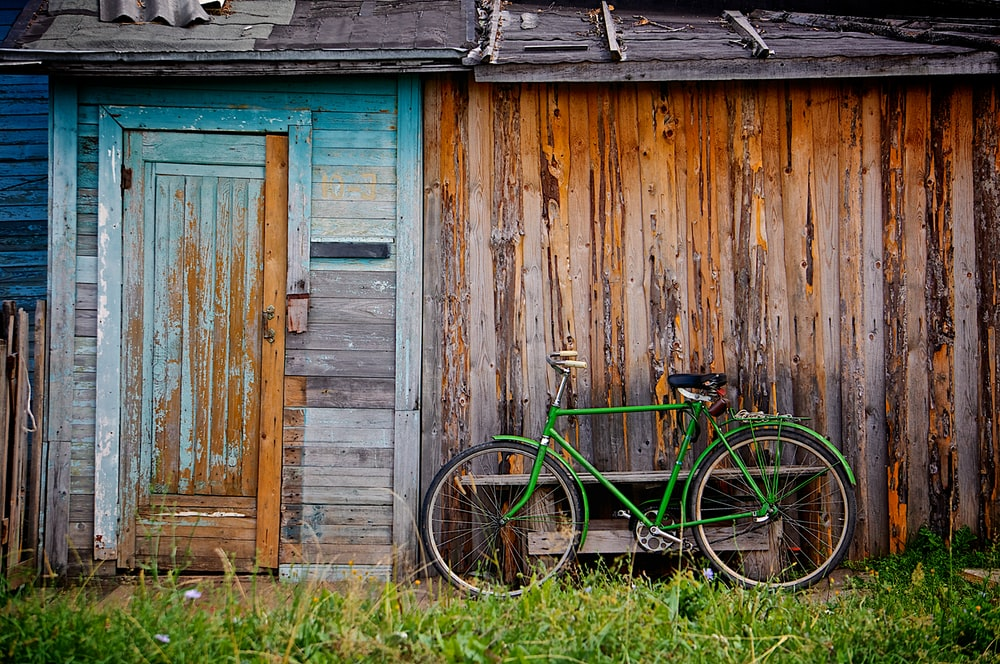 bicycle standing near house