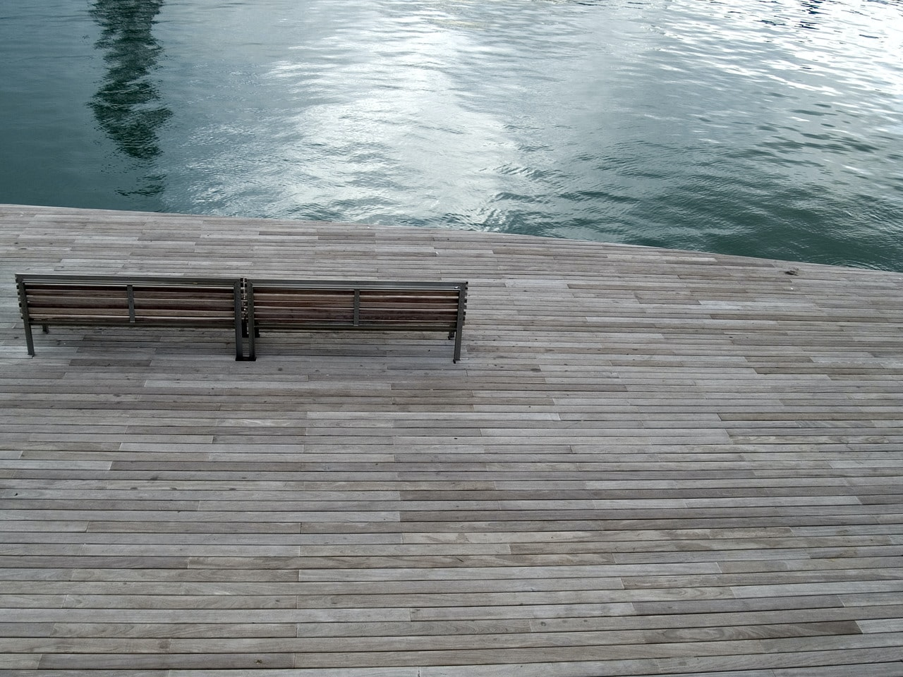 aerial photography of bench near body of water