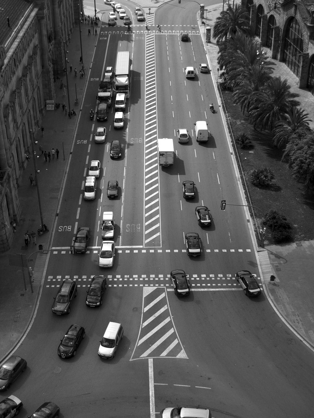 birds eye view of vehicles on road between buildings