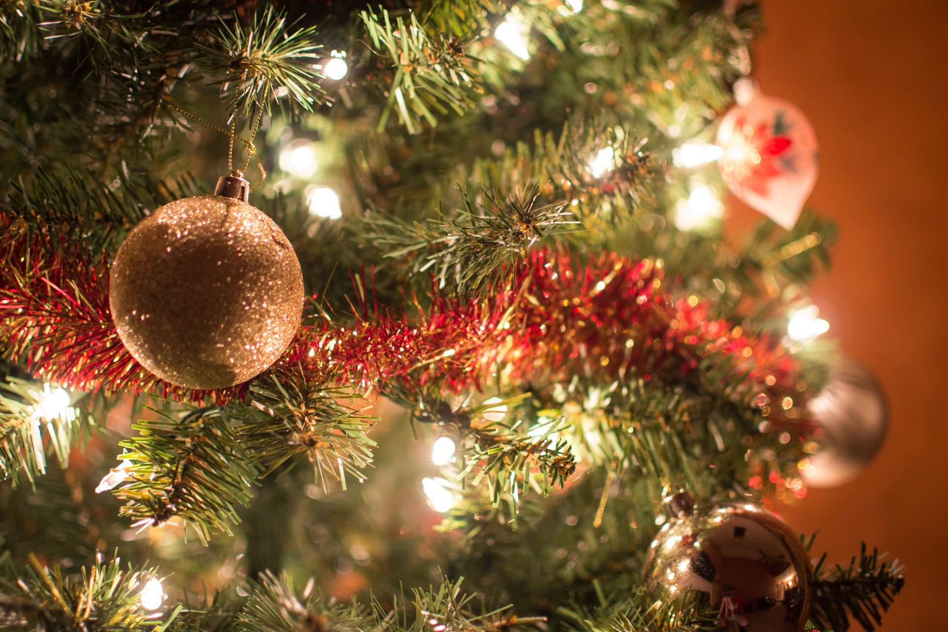close view of lighted Christmas tree with decors